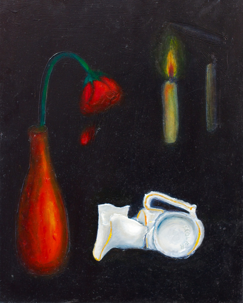 Broken cup beside red vase containing wilted rose. Lit candle in the distance on black background.