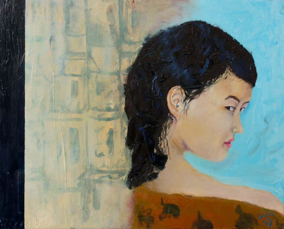 Girl looking back over her shoulder at viewer beside a curtain/wall