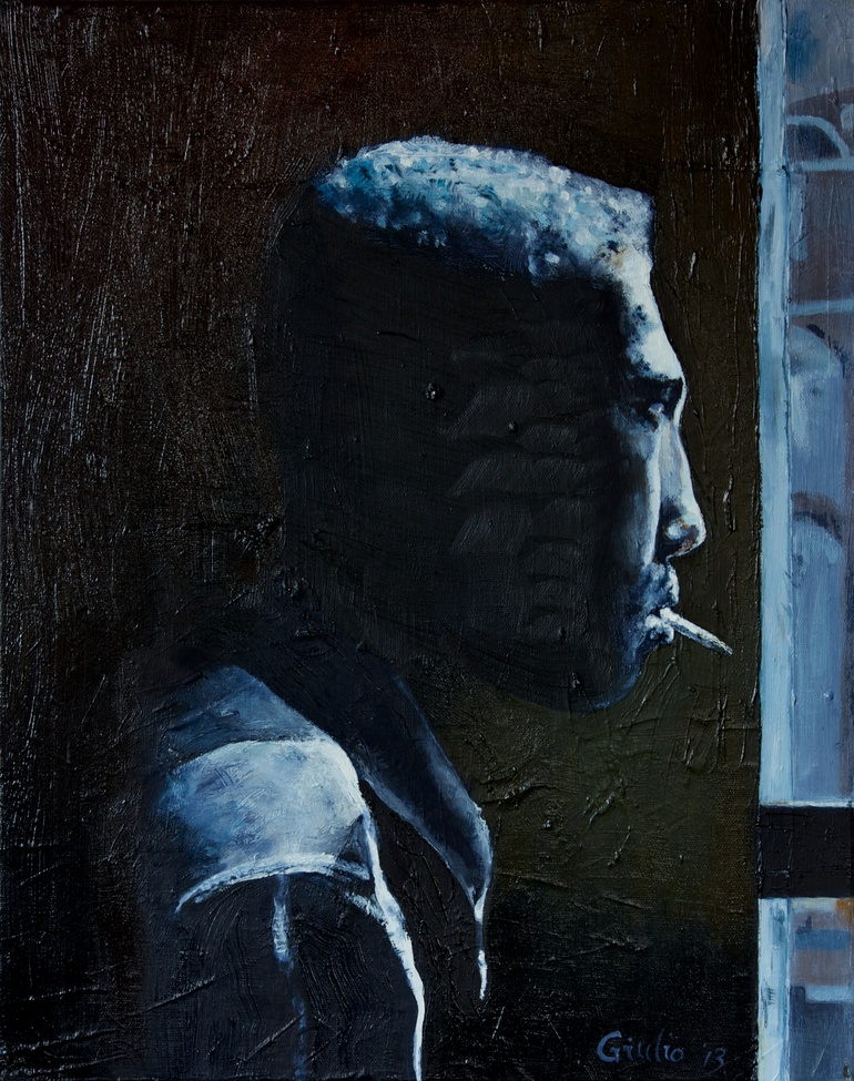 black and white image of a black man looking out a window