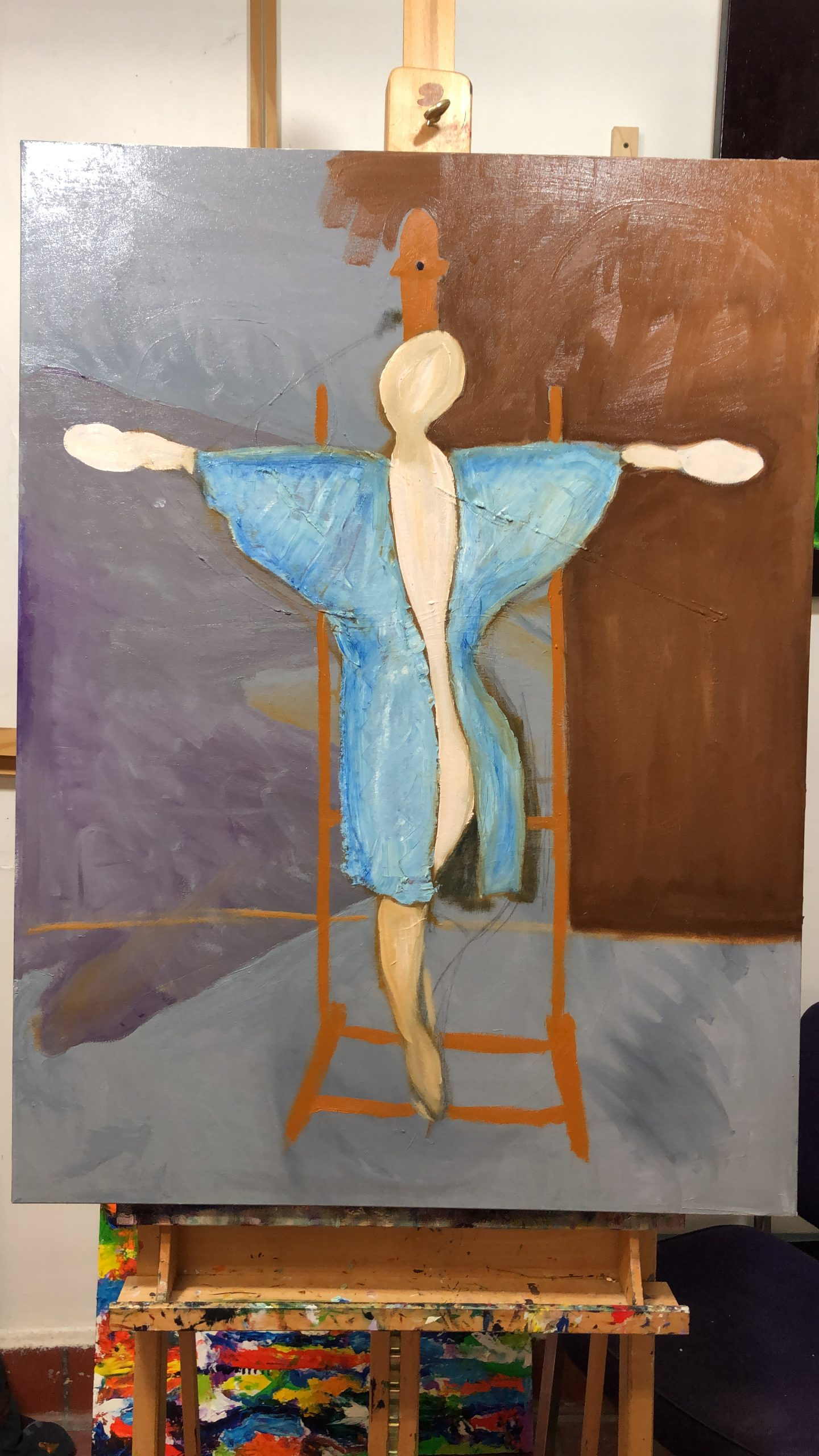 Half formed woman stepping down off an artist's easel